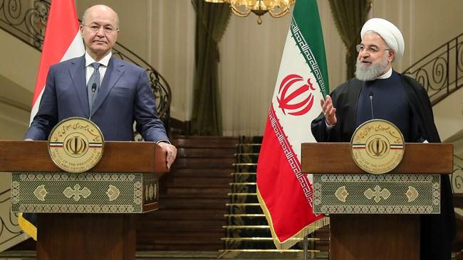 Iran and Iraq could raise their annual bilateral trade to $20 billion from the current $12 billion, President Hassan Rouhani said on Saturday, despite concerns over the impact of renewed U.S. sanctions.